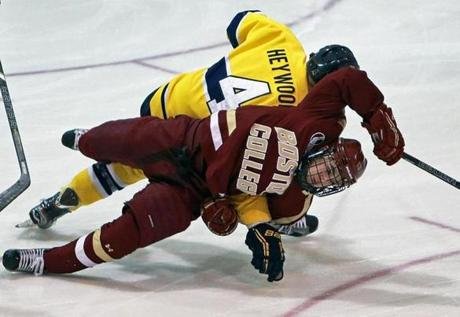 Merrimack's Jordan Heywood got a holding penalty for taking down Johnny Gaudreau 29 seconds into the game.